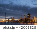 Petroleum refinery factory on water coast at dusk 42006828