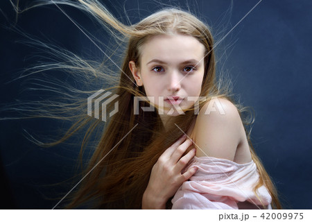 Beautiful woman with flying long hair. 42009975