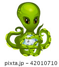 Cartoon green alien octopus holding in tentacles the embryo fish isolated on white background 42010710