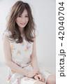 ヘアスタイル 女性 巻き髪の写真 42040704