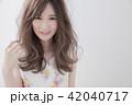 ヘアスタイル 女性 巻き髪の写真 42040717