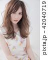 ヘアスタイル 女性 巻き髪の写真 42040719