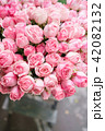 light pink bush roses flowers in vase on wooden table. Beautiful summer bouquet. Arrangement with 42082132