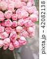 light pink bush roses flowers in vase on wooden table. Beautiful summer bouquet. Arrangement with 42082138