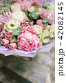 Beautiful summer bouquet. Arrangement with mix flowers. Flower bunch with peony on wooden table. The 42082145