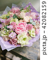 Beautiful summer bouquet. Arrangement with mix flowers. Flower bunch with peony on wooden table. The 42082159