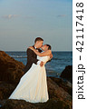 Bride and groom kissing on sunset light 42117418