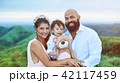 Smiling young latino family 42117459