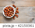 Hazelnuts on wooden table top view 42150361