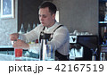 Bartender making alcohol coctail in restaurant 42167519