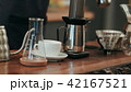 Barista pouring water on coffee ground with filter 42167521