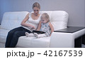 Mother and baby using digital tablet 42167539