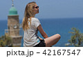 Young woman in sunglasses enjoying the sea view during vacation 42167547