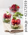 Spinach salad in glass. 42172959