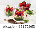 Spinach salad in glass. 42172963