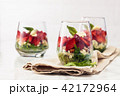 Spinach salad in glass. 42172964