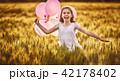 Girl running on cereal field 42178402