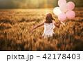 Girl running on cereal field 42178403