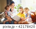 Mom and children reading a book 42178420
