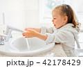 girl is washing hands 42178429