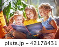 girls are reading a book 42178431