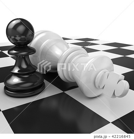 White pawn standing over fallen black king 42216845