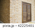 Brick wall building with wooden window 42225401