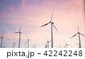 3d illustration of a beautiful, spectacular sunset on a background of wind turbines. Ecological net 42242248