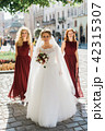 Young sensual bride with sexy bridesmaids posing on the square of old european town 42315307
