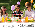 happy kids with cake on birthday party at summer 42341063
