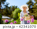senior woman garden tools and flowers at summer 42341070