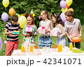 happy kids with gifts on birthday party at summer 42341071