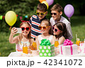 happy kids taking selfie on birthday party 42341072
