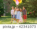 happy kids with balloons at summer birthday party 42341073