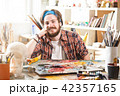 Portrait Of Smiling Male Artist 42357165