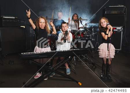 happy children singing and playing music 42474493
