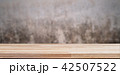 Empty wooden table over concrete vintage wall 42507522