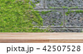 wooden table on concrete with moss background 42507528