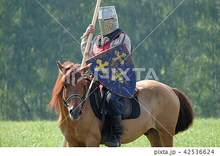 medieval knight with a spear riding a horse 42536624