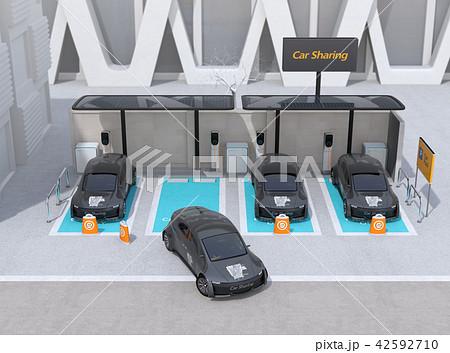 カーシェアリング専用駐車場に充電している電気自動車のイメージ 42592710