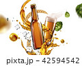 Beer glass with flying ingredients 42594542
