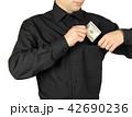 Businessman putting money in shirts' pocket 42690236