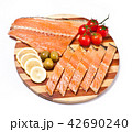 fresh red fish fillet on plate with vegetables 42690240