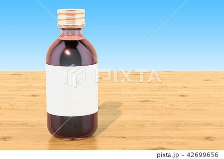 Pharmaceutical bottle on the wooden table 42699656