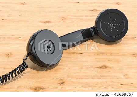Phone handset on the wooden table. 3D rendering 42699657