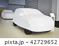 Two cars covered with white sheet 42729652