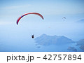 Parachute flying in clouds at top of mountains 42757894