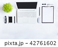 White desk office with laptop, smartphone and othe 42761602