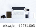 White desk office with laptop, smartphone and othe 42761603