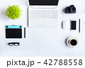 White desk office with laptop, smartphone and othe 42788558